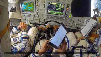 Even human spaceflight was ruined. Can you just enjoy the moment instead of playing with your tablet?