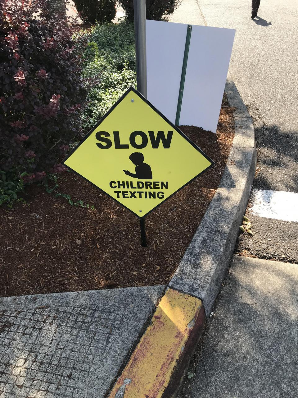 A local crosswalk has this sign instead of a crossing sign