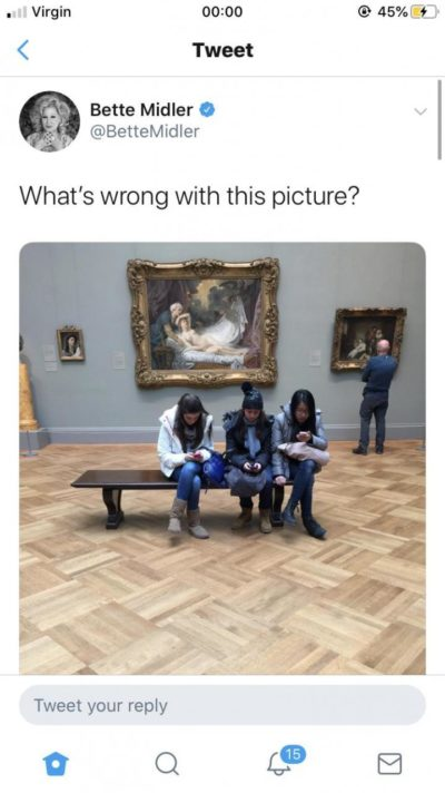 It's been immediately pointed out that the students were looking at a museum app with info about the paintings. Oh Bette…