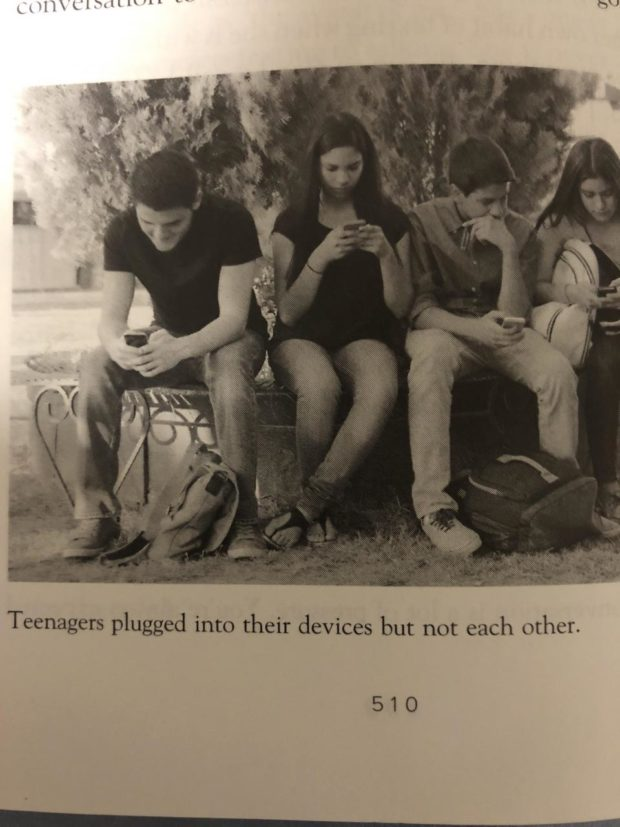Teenagers plugged into their devices but not each other. 510 https://inspirational.ly