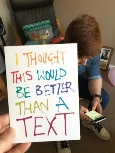 "This birthday card my mother-in-law bought my son. That's him, texting her ""thank you""."