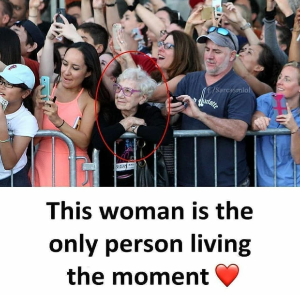 This woman is the only person living the moment Cf) https://inspirational.ly